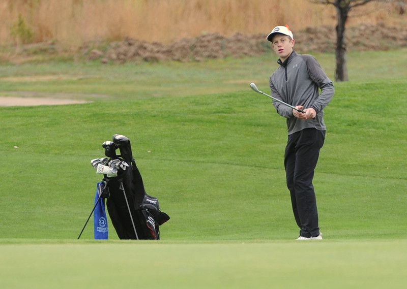 Berthoud's Cameron Poll watches his chip during the first round of the 4A state golf tournament on Monday at Raccoon Creek in Littleton.
