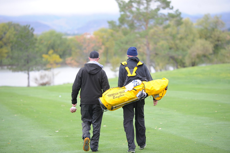 Thompson Valley coach Derek Shagin, left, and senior Darren Edwards walk up the 16th fairway during the first round of the 4A state golf tournament on Monday at Raccoon Creek in Littleton.