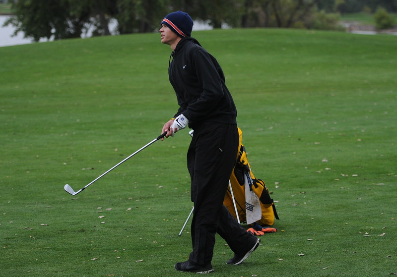 Thompson Valley's Darren Edwards watches his approach shot on the seventh hole during the first round of the 4A state golf tournament on Monday at Raccoon Creek in Littleton.