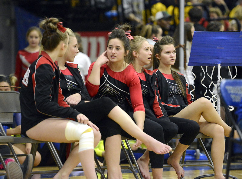 Loveland's gymnasts Hallie Lunsford, Morgan Kenner, Cadi Salza, Hannah White and Johanna Gillespe chat while waiting for balance beam scores to post at the 4A State Gymnasitcs meet at Thornton High School on Friday.