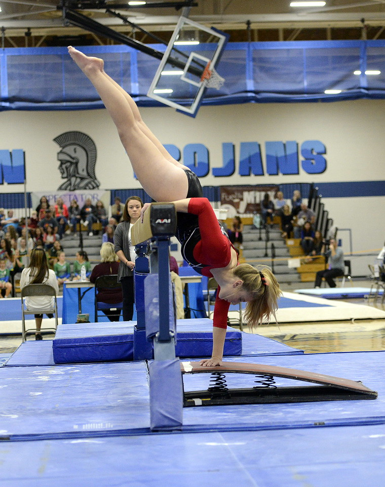 Loveland's Morgan Kenner begins her balance beam routine during the 4A State Gymnastics meet on Friday at Thornton High School.