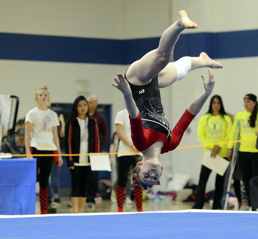 Loveland's Hallie Lunsford competes during the floor exercise Friday at the 4A State Gymnastics meet at Thornton High School. Lunsford scored an 8.80 on the event.