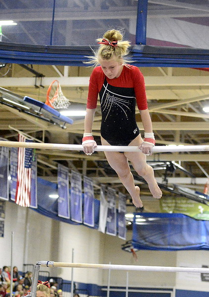 Loveland's Lauren Alexander competes on the uneven bars Friday at the 4A State Gymnastics meet at Thornton High School.