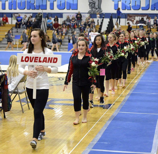 Loveland's gymnastics team walks out at the start of the 4A state meet Friday at Thornton High School.