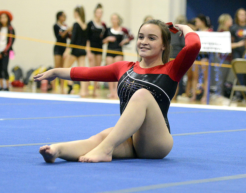 Loveland's Abby Gillespie competes during the floor exercise Friday at the 4A State Gymnastics meet at Thornton High School.