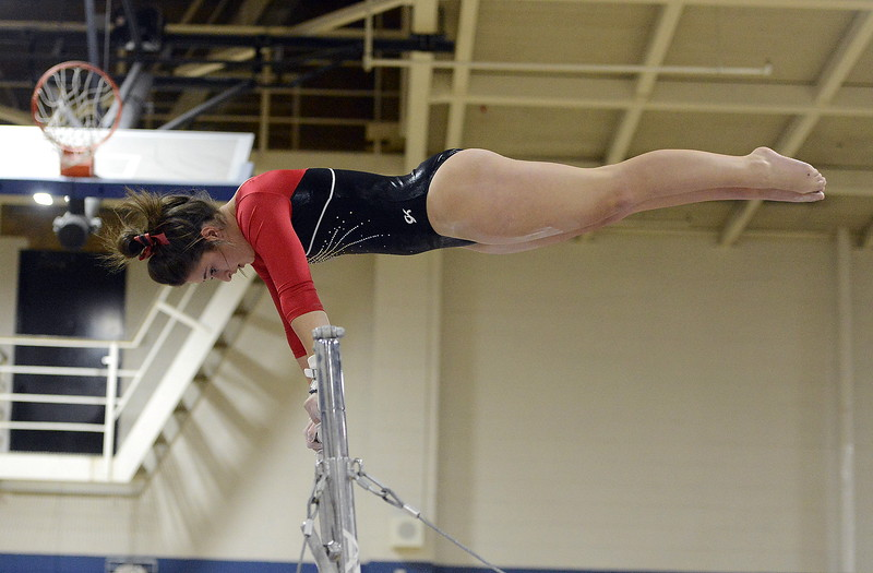 Loveland's Cadi Salza competes on the uneven bars during Friday's 4A State Gymnastics meet on Friday at Thornton High School.