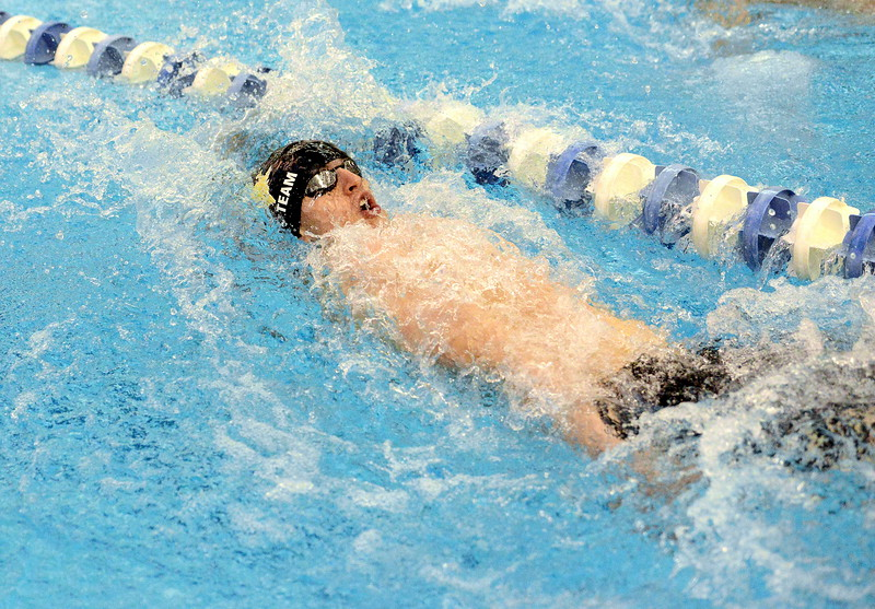 Lukas Gately of Thompson Valley hits the backstroke leg in the finals of the 200-yard individual medley  at the 4A state boys swim and dive meet Saturday at the Air Force Academy Natatorium. (Mike Brohard/Loveland Reporter-Herald)