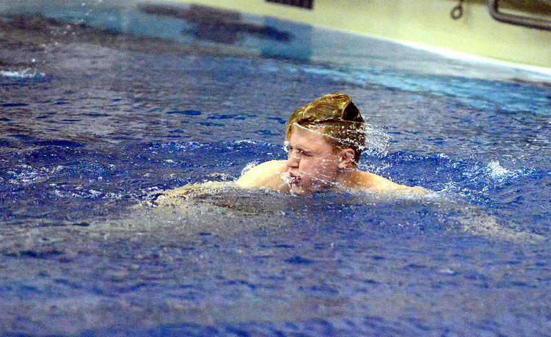 Hunter Williams of Thompson Valley shakes the water from his hair during the diving finals  at the 4A state boys swim and dive meet Saturday at the Air Force Academy Natatorium. (Mike Brohard/Loveland Reporter-Herald)
