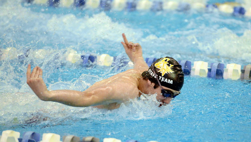 Ben Smith of Thompson Valley competes in the 100-yard butterfly consolation finals  at the 4A state boys swim and dive meet Saturday at the Air Force Academy Natatorium. (Mike Brohard/Loveland Reporter-Herald)