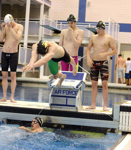 Thompson Valley's Jaiden Maycroft comes off the blocks over Lukas Gately during the consolation finals of the 200-yard medley relay  at the 4A state boys swim and dive meet Saturday at the Air Force Academy Natatorium. (Mike Brohard/Loveland Reporter-Herald)
