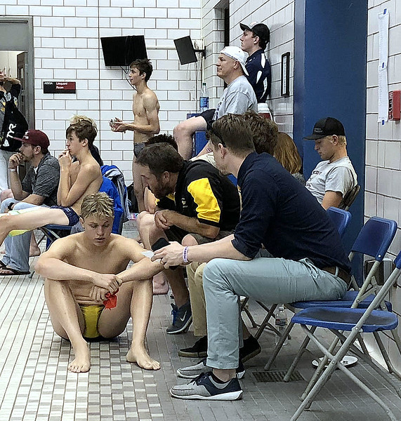Thompson Valley's Hunter Williams listens to instruction from coach Amon McCrary between dives in the preliminary rounds at the 4A state boys swim and dive meet Saturday at the Air Force Academy Natatorium. (Mike Brohard/Loveland Reporter-Herald)