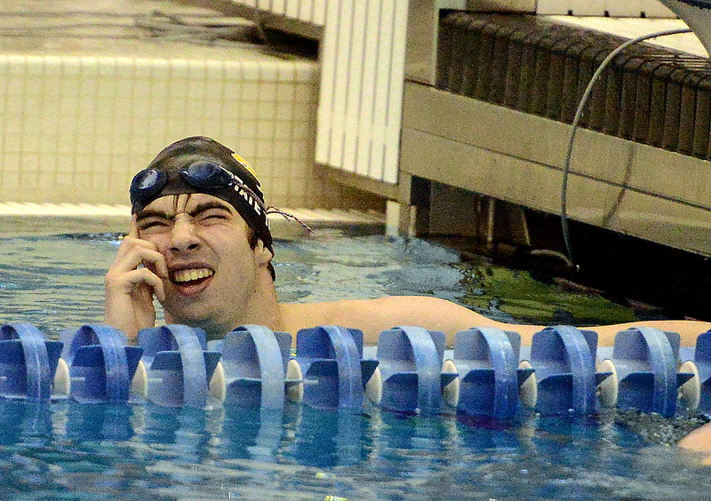 Ben Smith of Thompson Valley has to squint at the end of the 200-yard individual medley finals to see he placed fifth  at the 4A state boys swim and dive meet Saturday at the Air Force Academy Natatorium. (Mike Brohard/Loveland Reporter-Herald)