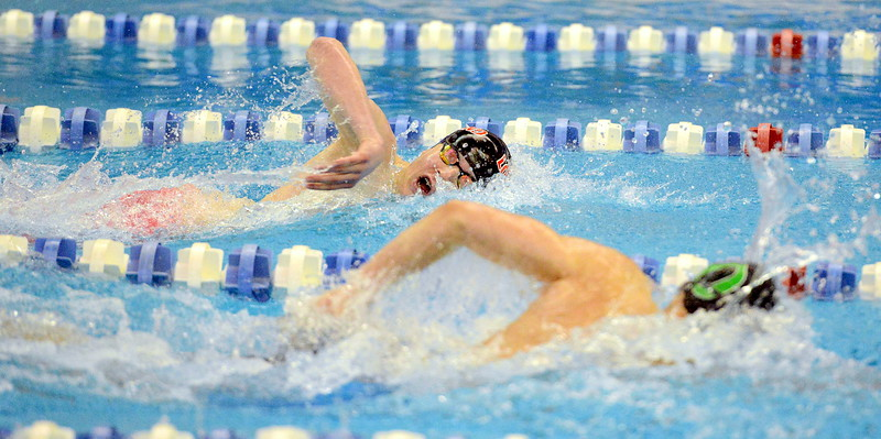 Loveland's Jakob Borrman digs in during the 200-yard freestyle on his way to a fifth-place finish in 1:44.06 at the 4A state boys swim and dive meet Saturday at the Air Force Academy Natatorium. (Mike Brohard/Loveland Reporter-Herald)