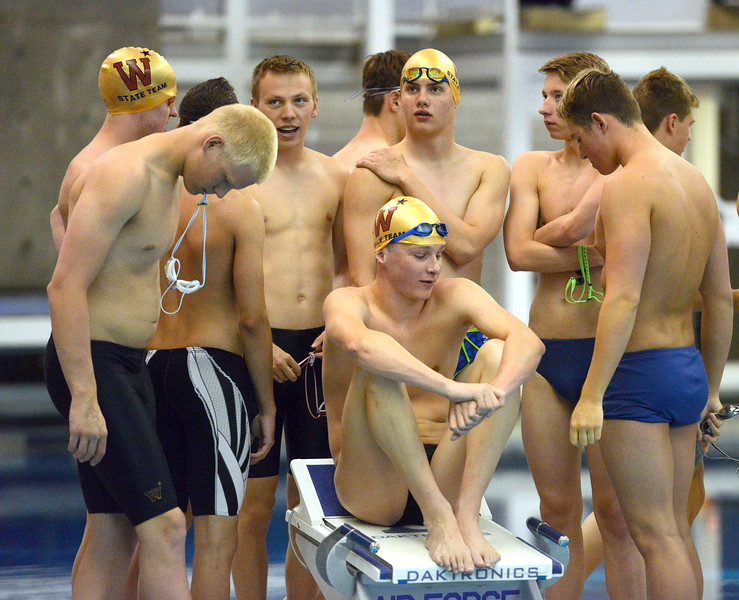 Windsor's Ethan Hansbury sits on the blocks as the Wizards wait for warmups at the 4A state boys swim and dive meet Saturday at the Air Force Academy Natatorium. (Mike Brohard/Loveland Reporter-Herald)