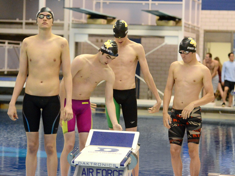 Thompson Valley's 200-yard medley relay team prepares for the consolation heat  at the 4A state boys swim and dive meet Saturday at the Air Force Academy Natatorium. (Mike Brohard/Loveland Reporter-Herald)