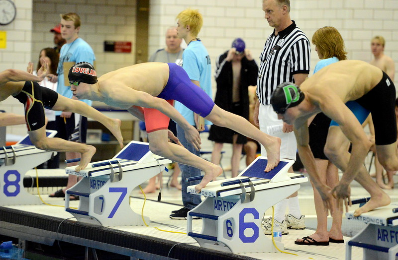 Jakob Borrman comes off the blocks at the start of the 200-yard freestyle finals  at the 4A state boys swim and dive meet Saturday at the Air Force Academy Natatorium. (Mike Brohard/Loveland Reporter-Herald)