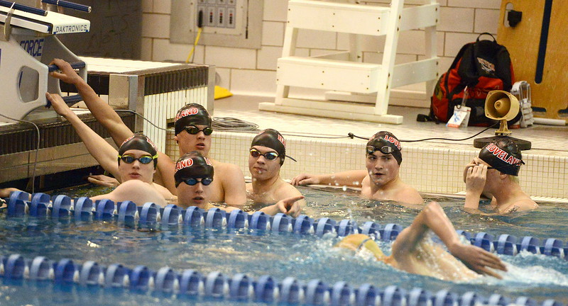 Loveland swimmers check the pace clock during warmups at the 4A state boys swim and dive meet Saturday at the Air Force Academy Natatorium. (Mike Brohard/Loveland Reporter-Herald)