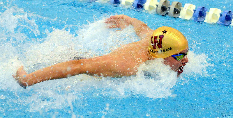 Windsor's Josh Dodrill competes in the finals of the 100-yard butterfly  at the 4A state boys swim and dive meet Saturday at the Air Force Academy Natatorium. (Mike Brohard/Loveland Reporter-Herald)