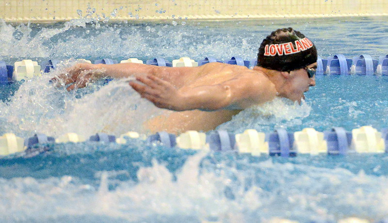 Loveland's Deven Gogarty competes in the 100-yard butterfly consolation finals  at the 4A state boys swim and dive meet Saturday at the Air Force Academy Natatorium. (Mike Brohard/Loveland Reporter-Herald)