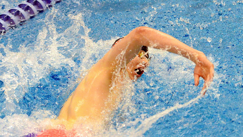 Lovleand's Jakob Borrman competes in the finals of the 100-yard freestyle  at the 4A state boys swim and dive meet Saturday at the Air Force Academy Natatorium. (Mike Brohard/Loveland Reporter-Herald)