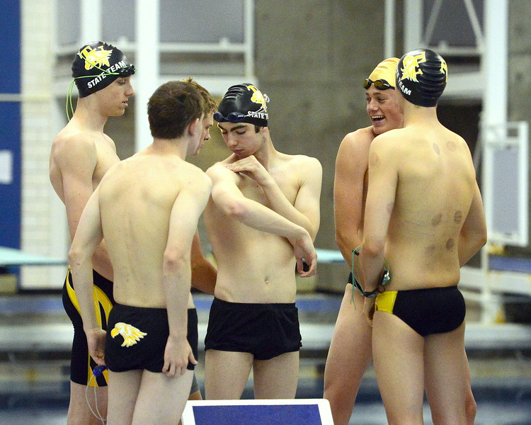 Windsor's Andrew Scoggins chats with Thompson Valley swimmers prior to warmups at the 4A state boys swim and dive meet Saturday at the Air Force Academy Natatorium. (Mike Brohard/Loveland Reporter-Herald)