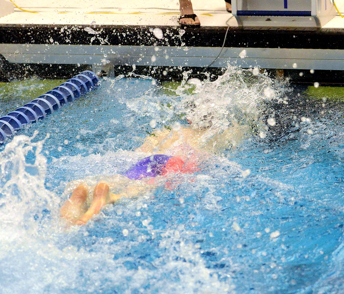 Loveland's Jakob Borrman closes out his seventh-place finish in the finals of the 100-yard freestyle  at the 4A state boys swim and dive meet Saturday at the Air Force Academy Natatorium. (Mike Brohard/Loveland Reporter-Herald)