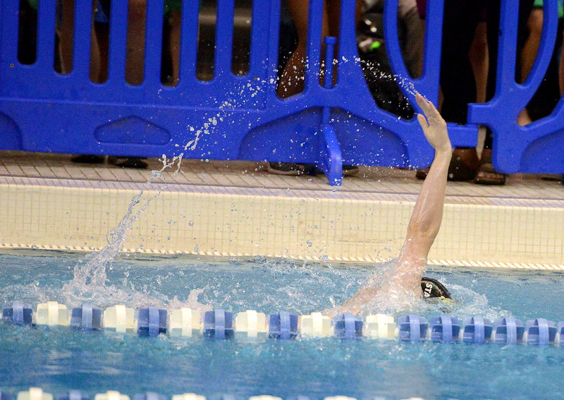 Thompson Valley's Ben Smith has the water following his fingertips during the backstroke portion of the 200-yard individual medley  at the 4A state boys swim and dive meet Saturday at the Air Force Academy Natatorium. (Mike Brohard/Loveland Reporter-Herald)
