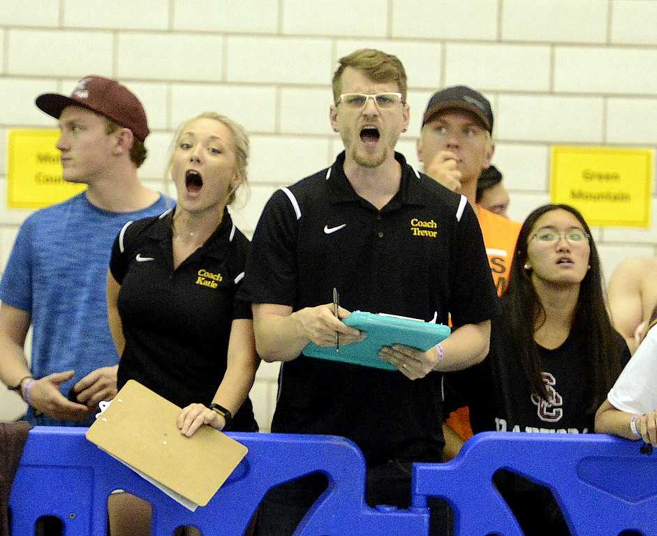 . Thompson Valley\'s coaches Katie Crossley and Trevor Ten Brink get excited and vocal watching Michael Vierra swim the 200-yard individual medley at the 4A state swim and dive preliminaries on Friday at the Air Force Academy Natatorium. (Mike Brohard/Loveland Reporter-Herald)