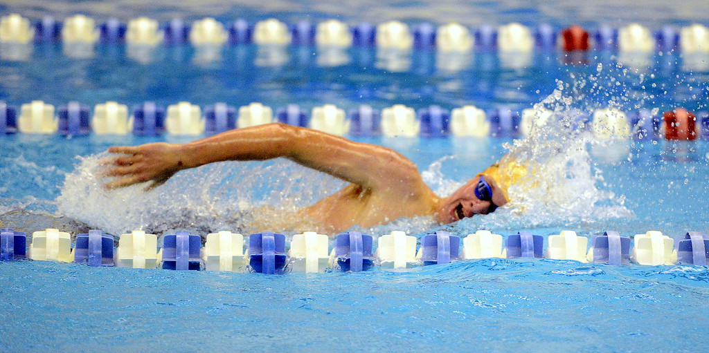 . Windsor\'s Ethan Hansbury competes in the 200-yard freestyle at the 4A state swim and dive preliminaries on Friday at the Air Force Academy Natatorium. (Mike Brohard/Loveland Reporter-Herald)
