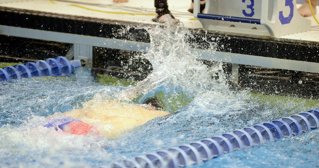 . Jakob Borrman of Loveland finishes full force at the 4A state swim and dive preliminaries on Friday at the Air Force Academy Natatorium. (Mike Brohard/Loveland Reporter-Herald)