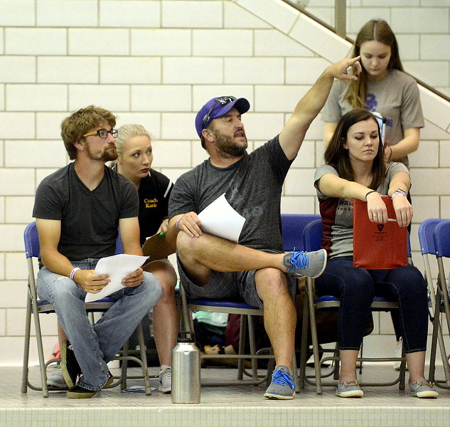 Thompson Valley diving coach Amon McCrary points to a diver and gives instruction as Loveland coach C.T. Robinson (right) looks on during diving practice Friday at the Air Force Academy Natatorium. (Mike Brohard/Loveland Reporter-Herald)