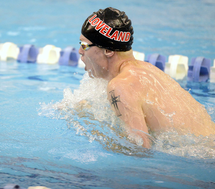 . Loveland\'s Danny Turner swims the breastsroke leg of the 200-yard medley relay at the 4A state swim and dive preliminaries on Friday at the Air Force Academy Natatorium. (Mike Brohard/Loveland Reporter-Herald)