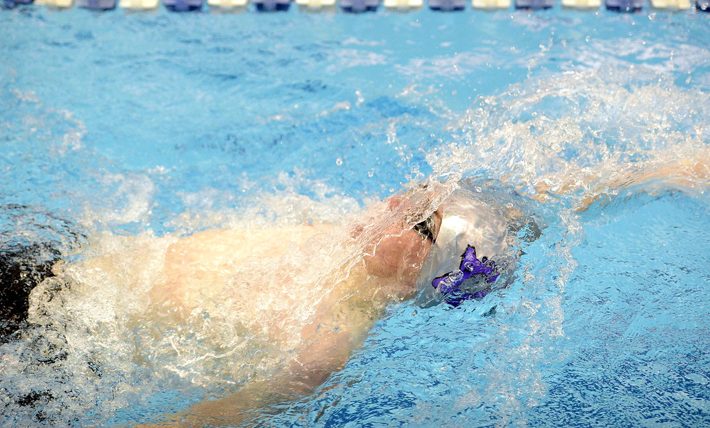 . Mountain View\'s Alex Gray competes in the 200-yard individual medley at the 4A state swim and dive preliminaries on Friday at the Air Force Academy Natatorium. (Mike Brohard/Loveland Reporter-Herald)