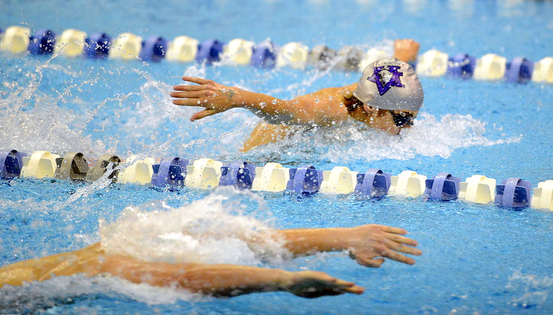 Mountain View's Max Bridges competes in the 100-yard butterfly at the 4A state swim and dive preliminaries on Friday at the Air Force Academy Natatorium. (Mike Brohard/Loveland Reporter-Herald)