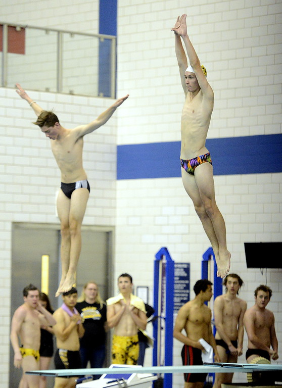 . Thompson Valley diver Logan Brian (right) stretches out as he tests the board at the Air Force Academy Natatorium in preparation for the 4A state swim and dive meet. (Mike Brohard/Loveland Reporter-Herald)