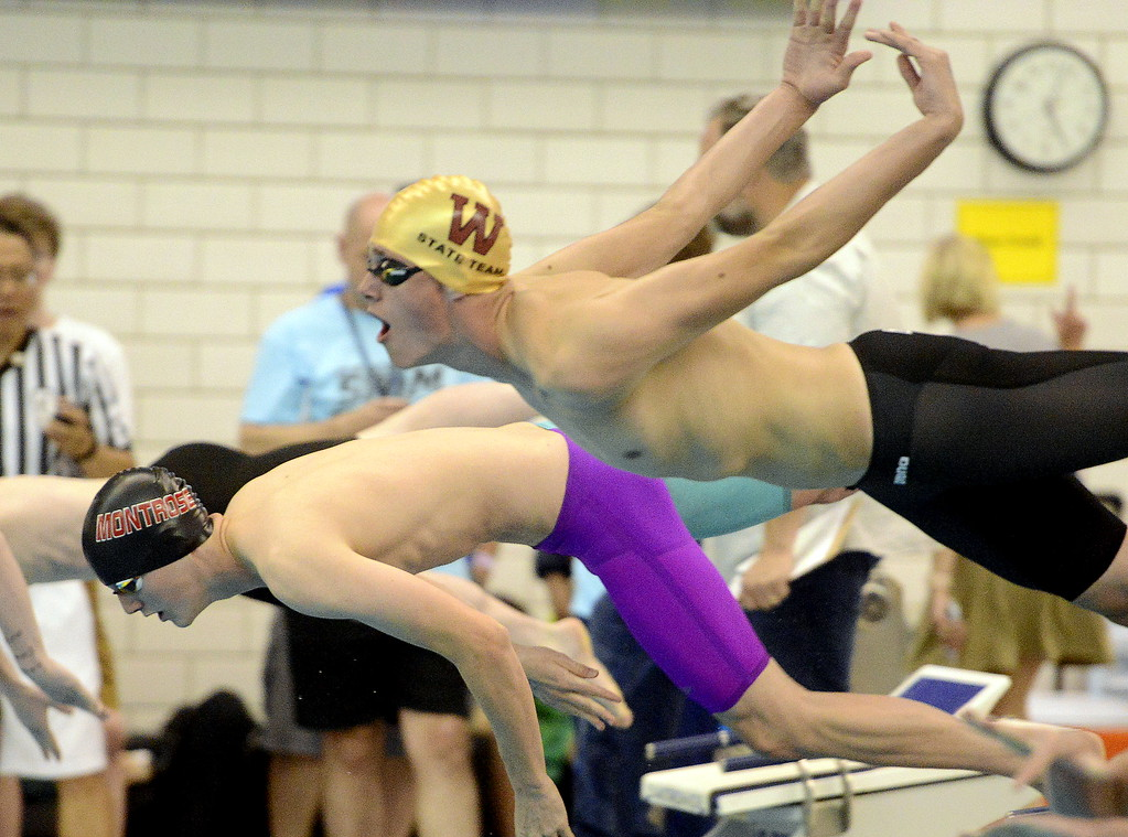 . Windsor\'s Andrew Scoggin comes off the blocks at the start of the 50-yard freestyle at the 4A state swim and dive preliminaries on Friday at the Air Force Academy Natatorium. (Mike Brohard/Loveland Reporter-Herald)