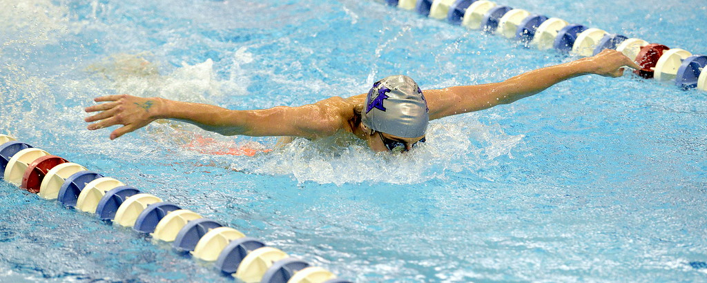. Mountain View\'s Max Bridges competes in the 200-yard individual medley  at the 4A state swim and dive preliminaries on Friday at the Air Force Academy Natatorium. (Mike Brohard/Loveland Reporter-Herald)