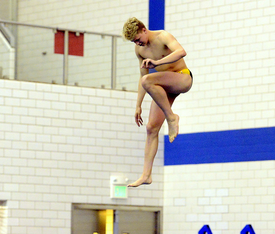 . Thompson Valley diver Hunter Williams tests the spring of the board at the Air Force Academy Natatorium on Friday in preparation for the 4A state swim and dive meet. (Mike Brohard/Loveland Reporter-Herald)
