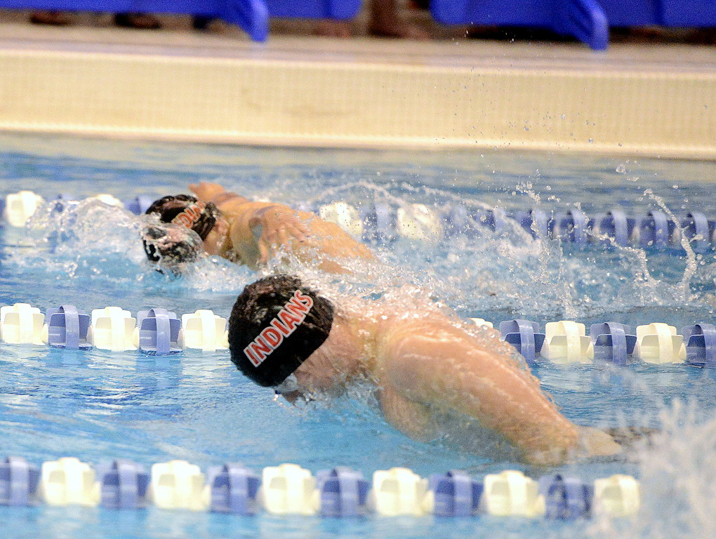 . Loveland\'s Connor Lindgren (near) and Indiana Steving compete in the 100-yard buttefly at the 4A state swim and dive preliminaries on Friday at the Air Force Academy Natatorium. (Mike Brohard/Loveland Reporter-Herald)