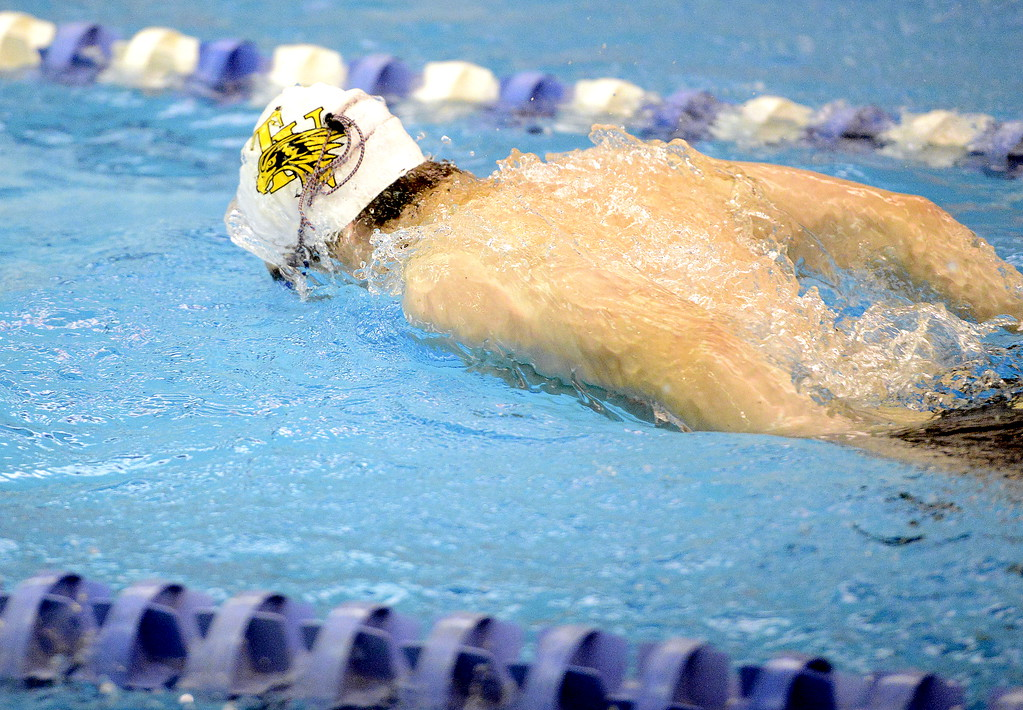 . Thompson Valley\'s Ben Smith pushes off the wall during warmups for the 4A state swim and dive meet Friday at the Air Force Academy Natatorium. (Mike Brohard/Loveland Reporter-Herald)