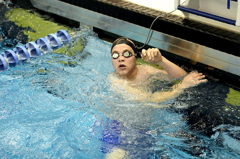 Loveland's Mason Alexander looks for his time on the board at the end of the 50-yard freestyle at the 4A state swim and dive preliminaries on Friday at the Air Force Academy Natatorium. (Mike Brohard/Loveland Reporter-Herald)