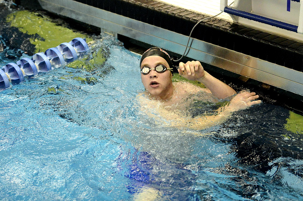 . Loveland\'s Mason Alexander looks for his time on the board at the end of the 50-yard freestyle at the 4A state swim and dive preliminaries on Friday at the Air Force Academy Natatorium. (Mike Brohard/Loveland Reporter-Herald)