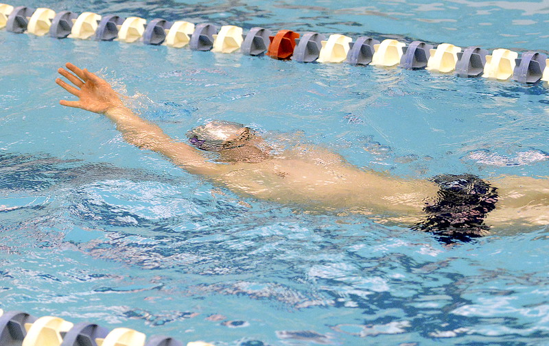 Mountain View's Alex Gray breaks the water as he works on backstroke in warmups Friday for the 4A state swim and dive meet at the Air Force Academy Natatorium. (Mike Brohard/Loveland Reporter-Herald)