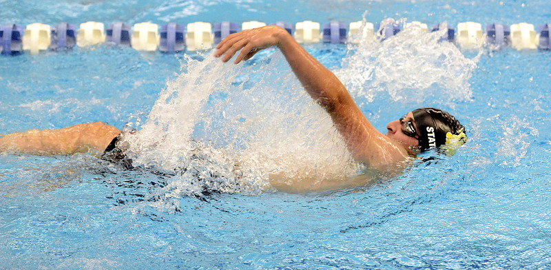 Michael Vierra of  Thompson Valley does the backstroke portion of the 200-yard individual medley at the 4A state swim and dive preliminaries on Friday at the Air Force Academy Natatorium. (Mike Brohard/Loveland Reporter-Herald)