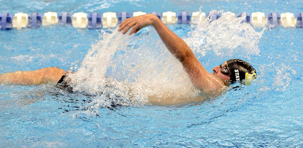 . Michael Vierra of  Thompson Valley does the backstroke portion of the 200-yard individual medley at the 4A state swim and dive preliminaries on Friday at the Air Force Academy Natatorium. (Mike Brohard/Loveland Reporter-Herald)