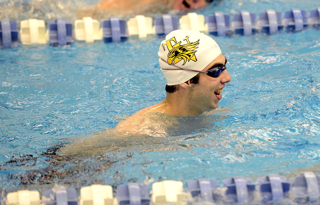 . Thompson Valley\'s Ben Smith laughs after bumping into a teammate during warmups Friday for the 4A state swim and dive meet at the Air Force Academy Natatorium. (Mike Brohard/Loveland Reporter-Herald)