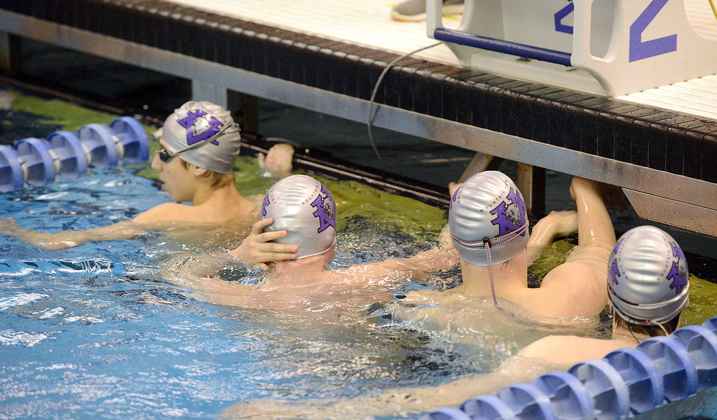 . Mountain View swimmers lineup up at the bulkhead during warmups Friday for the 4A state swim and dive meet at the Air Force Academy Natatorium. (Mike Brohard/Loveland Reporter-Herald)