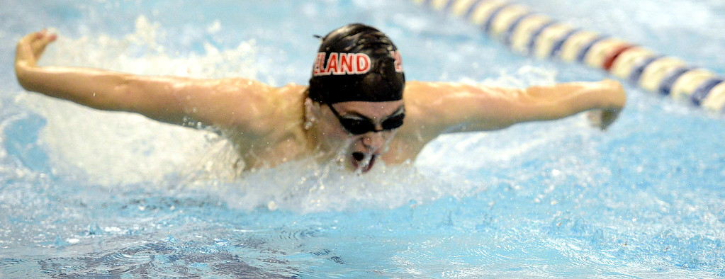. Loveland\'s Aiden Duncan comes up for air during the 100-yard butterfly at the 4A state swim and dive preliminaries on Friday at the Air Force Academy Natatorium. (Mike Brohard/Loveland Reporter-Herald)