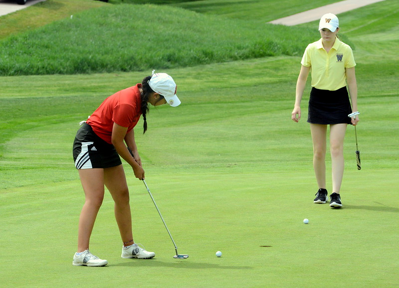 Loveland's Natalle Hall putts as playing partner Brynn Ellis of Windsor waits her turn during the first round of the 4A state girls golf tournament Monday at Country Club of Colorado in Colorado Springs (Mike Brohard/Loveland Reporter-Herald)