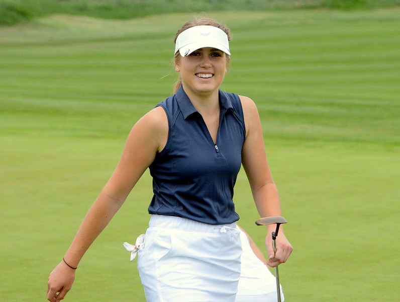 Mountain View's Renee Demaree is all smiles after dropping a birdie putt on No. 2 during the first round of the 4A state girls golf tournament Monday at Country Club of Colorado in Colorado Springs. Demaree shot an 87 to sit in a tie for ninth. (Mike Brohard/Loveland Reporter-Herald)